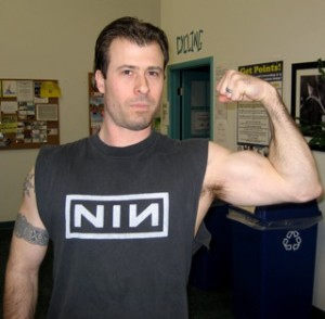 Eric Shows off his biceps